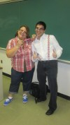 """English teacher Ms. Mellene Hederian and senior Greg Paul planned in advance to dress together as nerds for Halloween. Here they wear their matching """"broken"""" nerd glasses."""
