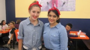 Junior Marti Rose Shanker (left) and senior Mukta Oberoi look strong while wearing their Rosie the Riveter outfits.