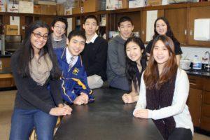 JHS semifinalists Ken Aizawa, Matthew Chun, Chenle (Leo) Hu, Xingan (Ian) Hua, Preeti Kakani, Dohee (Diane) Na, Kaitlyn Shin, and Amy Xu pose for a picture