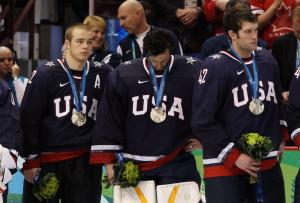 Players from Team USA are forced to look on after losing the gold medal game to Team Canada in the 2010 Winter Olympics (Photo by Bruce Bennett/Getty Images).