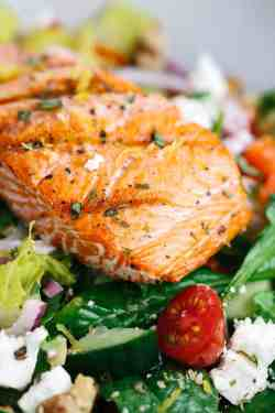 Encouraging Salmon Fillet Placed On A Bed Lettuce Tomatoes Grilled Salmon Greek Salad Lemon Basil Dressing Jessica Gavin Salmon Steak Recipe Ideas Salmon Steak Recipe Jamie Oliver