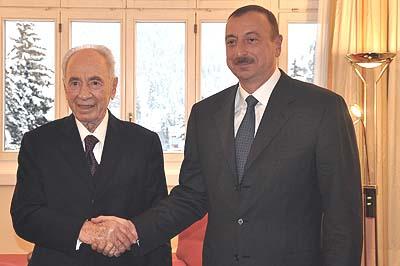 Israeli president Shimon Peres shakes hands with the President of Azerbaijan, Ilham Aliyev.