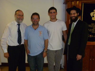 (L-R) Mohel David Katche, Itzchak Yoel, Moshe Chaim, and Rabbi Arieh Raichman after the seudat mitzvah.