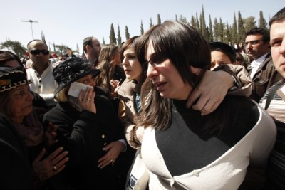 Eva Sandler at the Burial of Rabbi Jonathan, Aryeh, and Gavriel