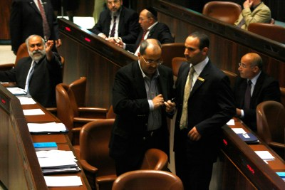 MK Ahmed Tibi being escorted from the Knesset plenum
