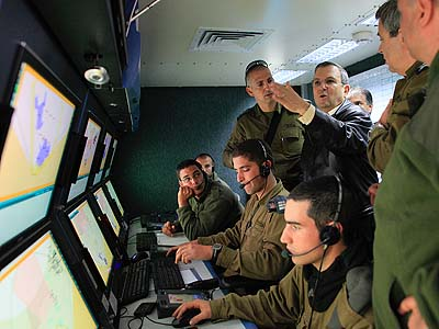 "Israeli Defense Minister Ehud Barak, rear right, visits the ""Iron Dome"" control room."