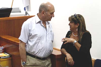 Former Israeli PM Ehud Olmert in court with a former aide. Both face corruption charges.