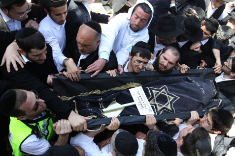 Mourners attend the funeral in Jerusalem of Rabbi Jonathan Sandler, 30, his 6-year-old son Arieh, his 3-year-old son Gabriel, and 8-year-old Miriam Monsonego killed a few days ago when a gunman shot and killed the four at a Jewish school in Toulouse, France.