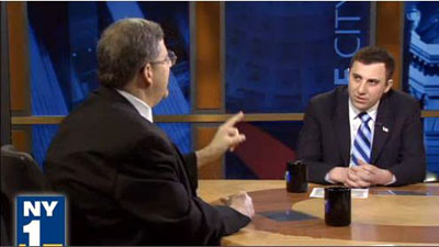 Lew Fidler (left) making a point during the debate against Republican David Storobin, which originally aired on channel NY1.