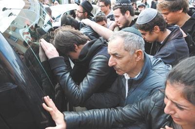 Mourners at Ozar Hatorah school in Toulouse, France, bid farewell to coffins bearing victims of Monday's massacre at funeral ceremony on Tuesday.