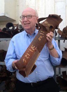 Dr. George O. Wood holds the remnant of a Kassam reocket in Sderot.