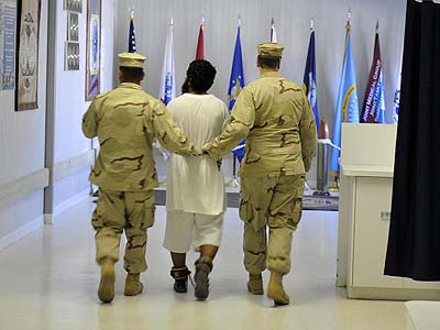 A detainee is escorted hospital at Guantanamo Bay.