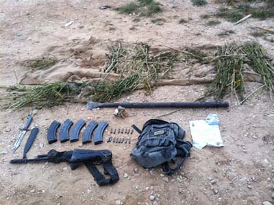An AK-47 assault rifle and ammunition were found next to a killed terrorist's body Monday morning.