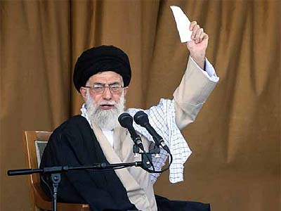"Iran's Supreme Leader Ayatollah Ali Khamenei delivering a speech on November 8, 2006, where he stated that his country would continue to acquire nuclear technology and challenge ""Western fabrications."""