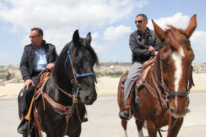 Captain Dudi Chayun, on left, is the head of the Tachant Shalem police station. On right is Captian Lior, head of mounted police unit in Jerusalem. The Temple Mount can be seen behind them.