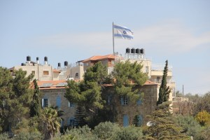 Jewish life is returning the the Mount of Olives. The famous Israeli flag above the Choshen building signifies Jewish presence.