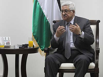 PA President Mahmoud Abbas at the Mukataa in Ramallah, where he regularly updates his Facebook account.