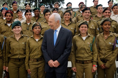 Israeli President Shimon Peres preparing for this year's Yom Haatzmaut ceremony