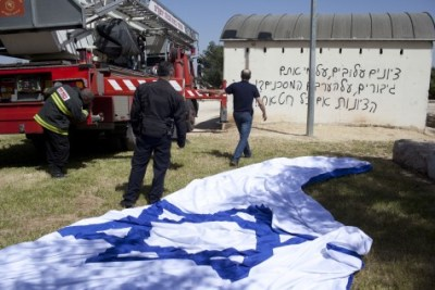 Hate slogans against Zionism and Jews spray-painted on a site commemorating fallen IDF soldiers on Ammunition Hill, Jerusalem.