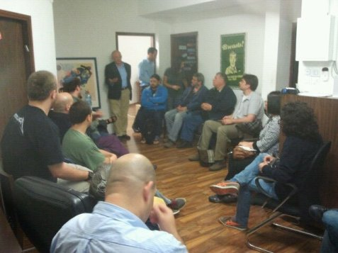 MK Aryeh Eldad talking to activists and supporters of the Hatikva Party at its Tel Aviv headquarters
