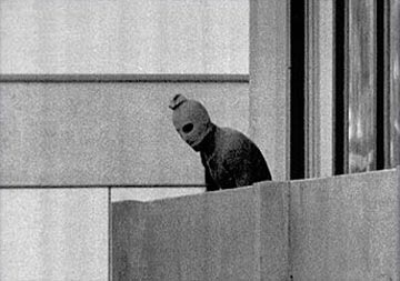 Image of Black September Terrorist at 1972 Munich Games, Peering Out from Israeli dorms Kurt Strumph