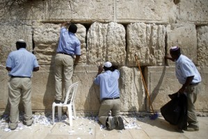 Western Wall workers remove thousands of handwritten notes placed between the ancient stones of the Western Wall, Judaism's holiest site in the Old City of Jerusalem. The operation is carried out twice each year: before the Passover festival which begins next week and at the Jewish New Year in the fall.