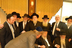 Rabbi Hecht surrounded by rabbis.