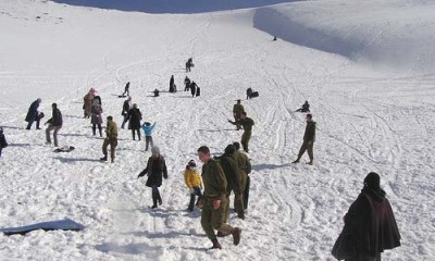 Arab Children with Cancer with Alpine Soldiers on Mt. Hermon