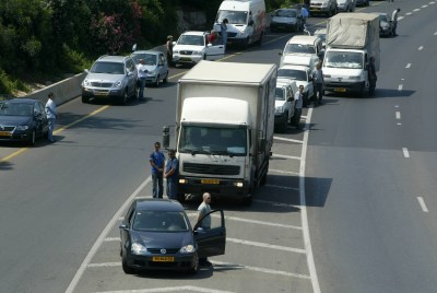 Israelis standing next to their cars as the two-minute siren is sounded across Israel to mark Yom Hazikaron