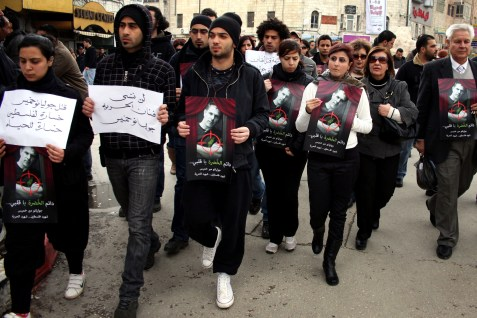 Palestinians marching in memory of Israeli-Arab actor and director Juliano Mer Khamis who was shot and killed by a masked gunman during a rally in Ramallah