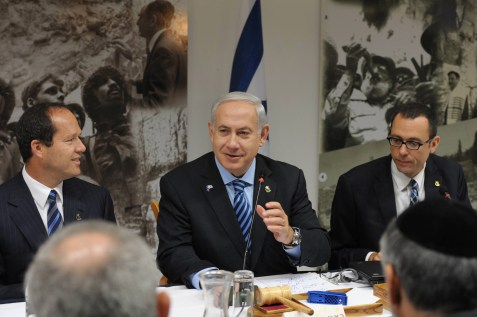Prime Minister Benjamin Netanyahu sits next to Jerusalem Mayor Nir Barkat during a special cabinet meeting marking Jerusalem Day at Ammunition Hill in Jerusalem