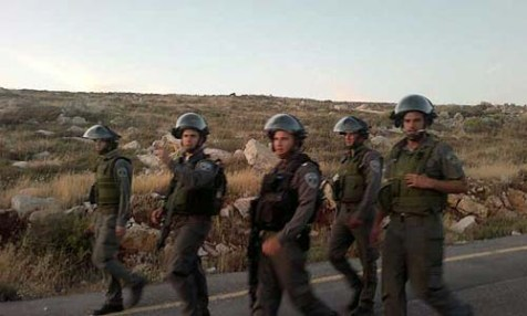 Border Guards marching into Ramat Migron in an attempt to stop a wedding.