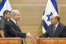 Prime Minister Benjamin Netanyahu (left) and Kadima chairman Shaul Mofaz hold a joint press conference at the Knesset Tuesday after announcing a surprise agreement to form a coalition government.
