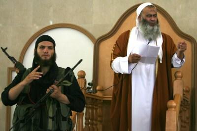An Islamic preacher delivering a Friday prayer sermon