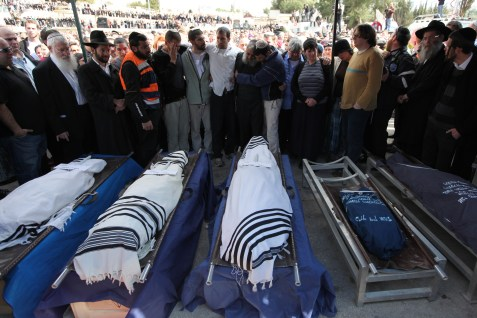 The funeral of the five Fogel family members murdered in their home in Itamar.