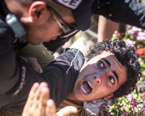 Police subduing a minor during a demonstration in front of the Knesset on Wednesday. The youth was detained and today was released unconditionally.