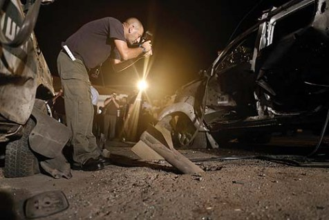 Tuesday night an Israeli police sapper photographed the scene of a Kassam rocket that hit a Border Guard base near kibbutz Yad Mordechay, causing injuries and damage.