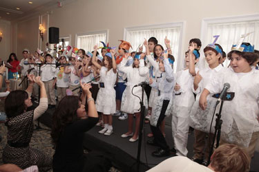 Children perform at Chabad's after school commencement.