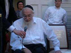 The rosh yeshiva speaks to well-wishers.