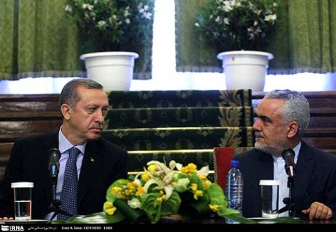 Iran's First Vice President Mohammad Reza Rahimi R.) with Turkey's Prime Minister Recep Tayyip Erdogan.