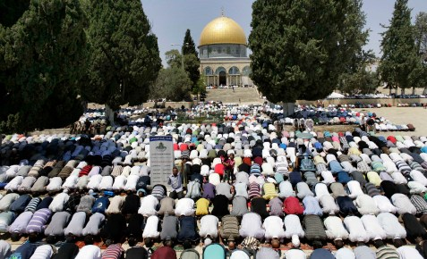 Muslims praying in front of the Dome of the Rock