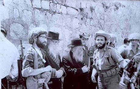 Rabbi Ariel (the bearded paratrooper on the left) bringing his teachers The Nazir and Rabbi Tzvi Yehuda Kook to the Kotel soon after its liberation.