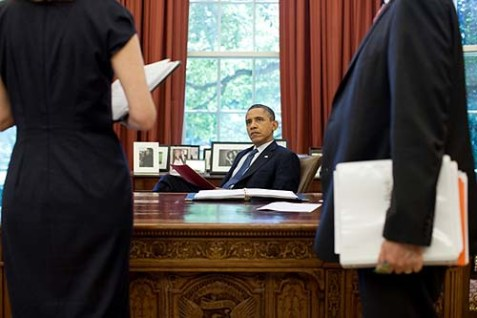 "President Obama at his desk, secure in his status as ""natural born citizen."""