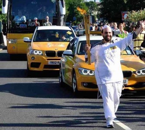 Efrayim Goldstein carries Olympic torch through London's streets.