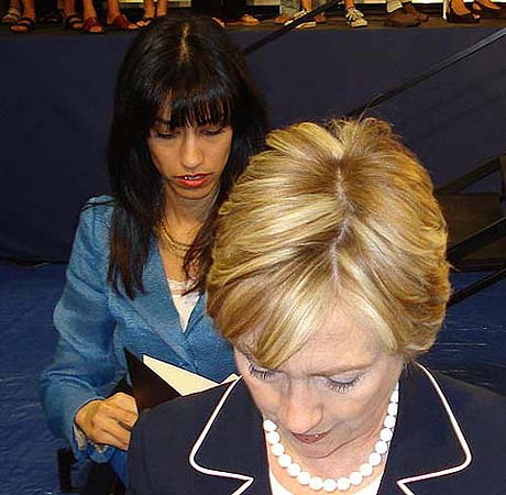 Earlier, Rep. Bachmann also accused Huma Abedin, seen here behind her boss, Secretary of State Hillary Clinton, of ties to the Muslim Brothers.