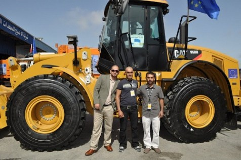 A ribbon-cutting ceremony for the Palestinian Authority's purchase of Caterpillar equipment from Palestinian Tractor & Equipment Co.