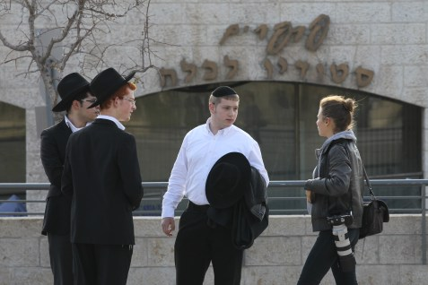 Secular woman talking with ultra-Orthodox youth