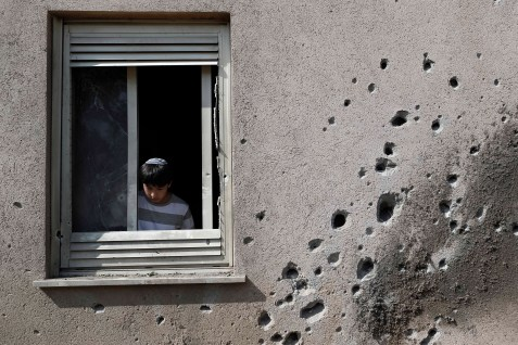 Shrapnel damage to a home in the Gaza Belt after a Qassam rocket exploded in a yard. (archive)