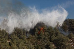 A forest fire rages in a suburban area outside of Jerusalem.