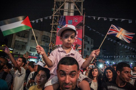 Palestinians celebrating the opening of the 2012 Olympics Games